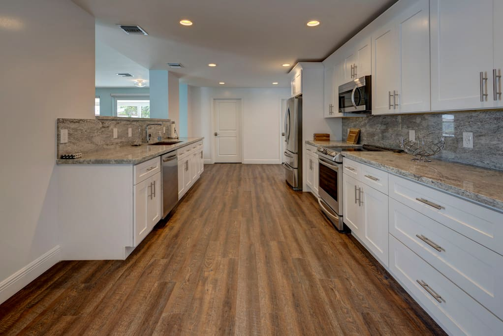 Brand new bright kitchen with stainless steel appliances & granite counters!