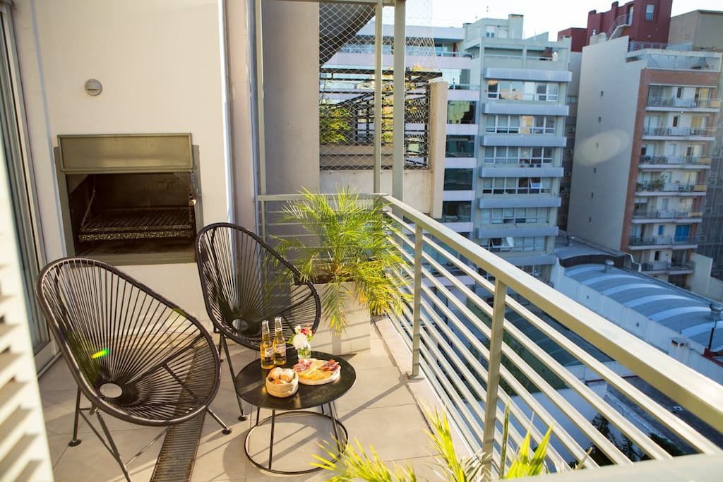 """Balcony with a classic  Argentinian """"parrilla"""" barbacue."""