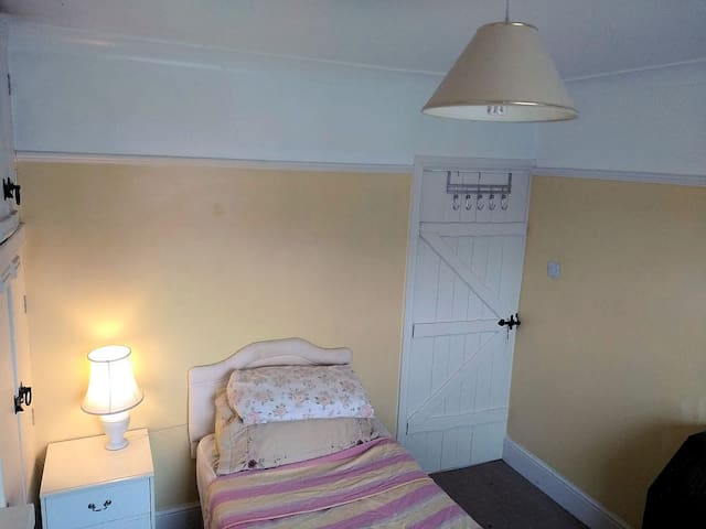 Clean wholesome room, warm in winter / cool in summer, highly insulated - solar heating and lighting. Lots of wardrobe and cupboard space.