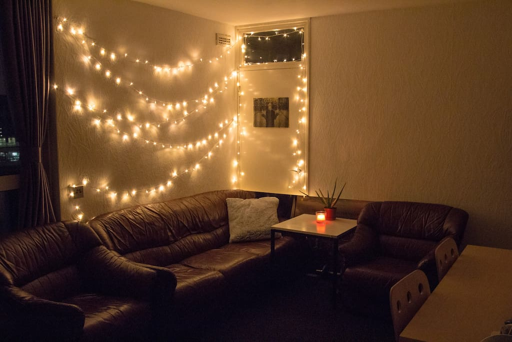Fairy lights in bedroom 1, for that sense of cosiness. The big sofa is the one the third person can sleep on (we have an extra duvet).