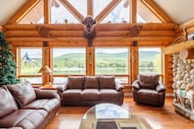Huge living room soaring high ceiling huge log beams and walls this is a real log cabin