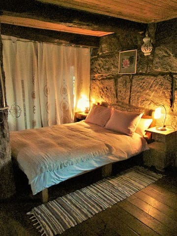 Cozy, double bed in an open space room