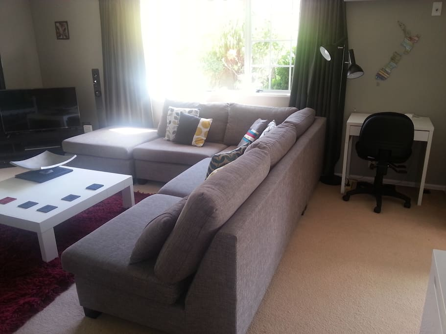 Large lounge with Sky TV, blue-ray player with surround sound, small desk space.