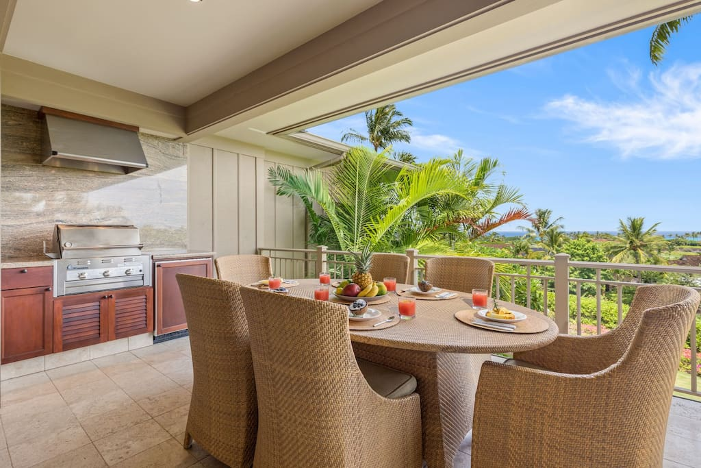 Elegant lanai dining set for six and built-in barbecue grill. Eat al fresco while gazing out over stunning resort grounds to the ocean.