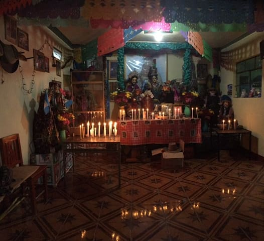 The family has a Mayan altar/ Cofradia in the home