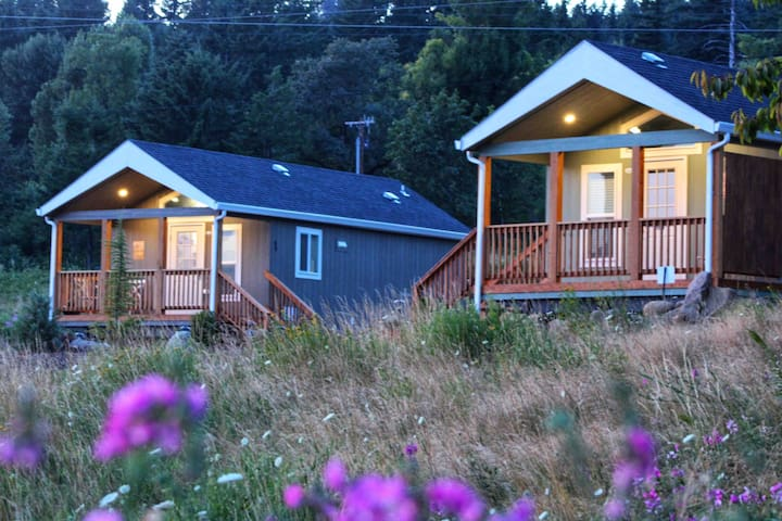 Redbluff Cabin on the Right and Creekside Cabin on the left. We love our field in the summer!