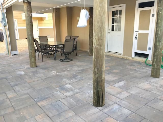 Ground floor patio with outside shower and grill