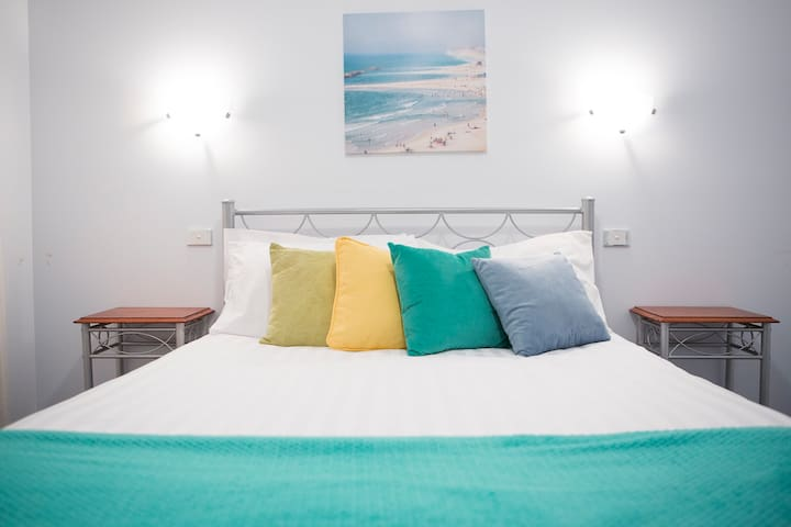 Lovely white linen on Queen bed