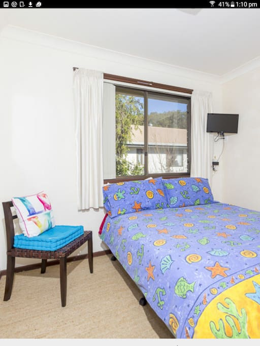 Double bed or great kids room with a small TV screen