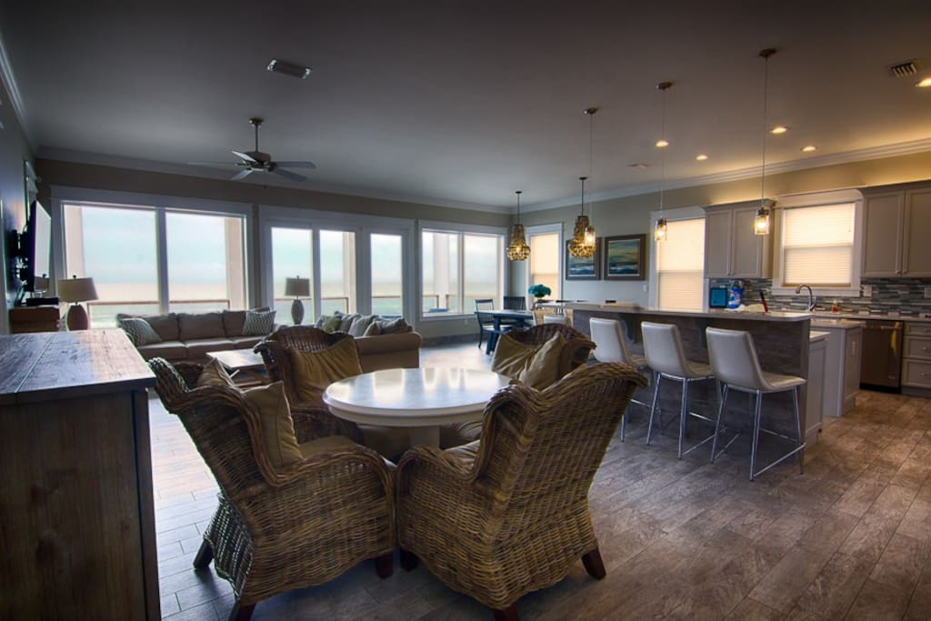 Get the entire family togther in this large living area with dining and kitchen area in background