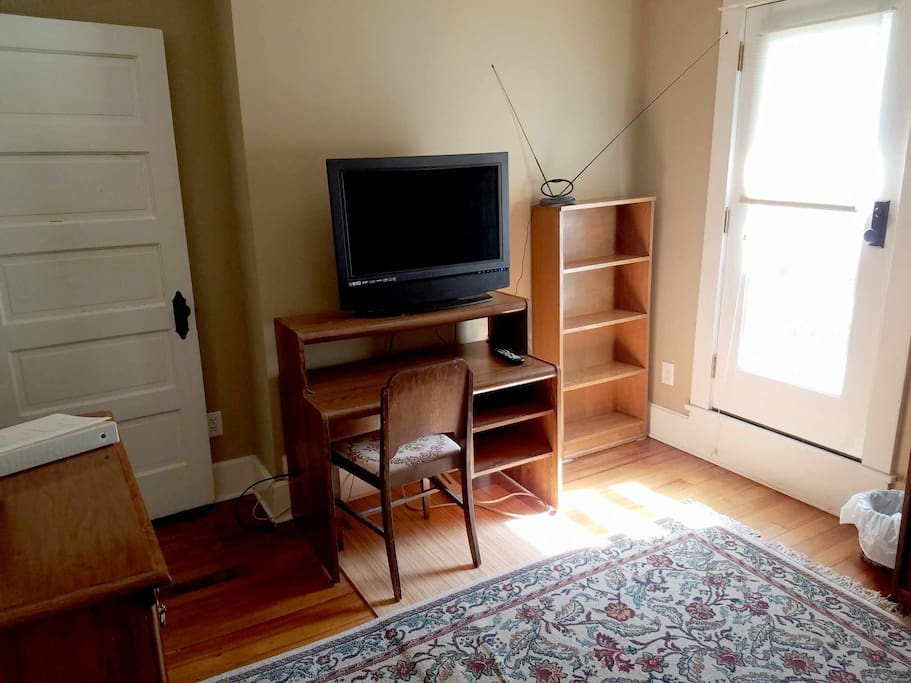 The bedroom has a desk, shelving, and a TV which can be hooked up with a laptop computer.