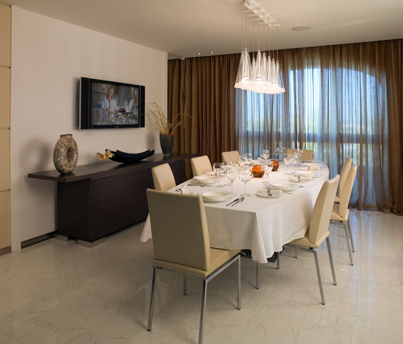 The villa includes a number of different options for dining. This is the formal one for 8 people.