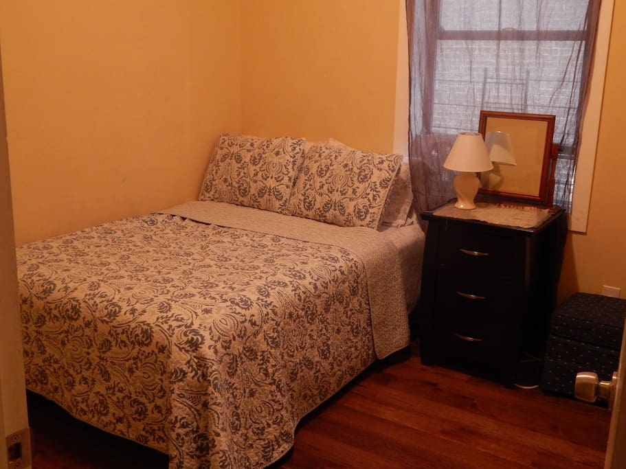The bedroom, with full-size bed.