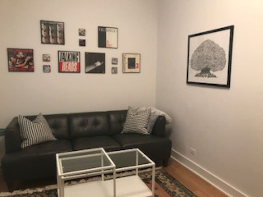 The living room features some of our favorite album art as well as images of local street art...