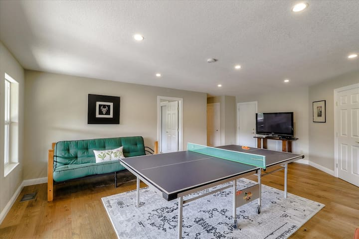 """Common Space With Ping Pong Table on Lower Level and 55"""" Roku TV with Google Chromecast. (Only 1 of 2 Full-Size Futons Shown in Picture)"""