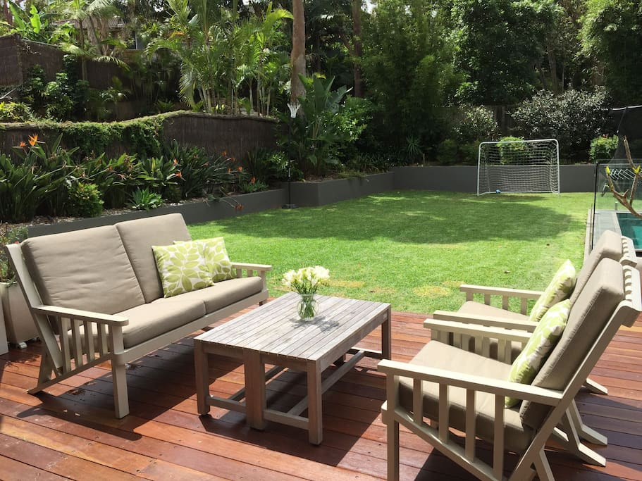 View from the living area. Flat lawn for the kids to play. Direct access to pool and huge springfree trampoline.