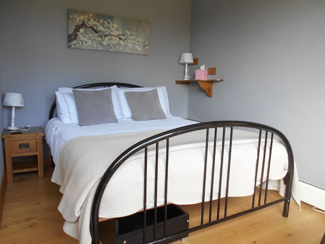 Double bed with storage underneath.