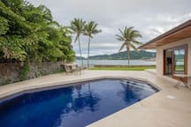 Pool right off master suite. Take a dip in the pool while looking out to the bay.
