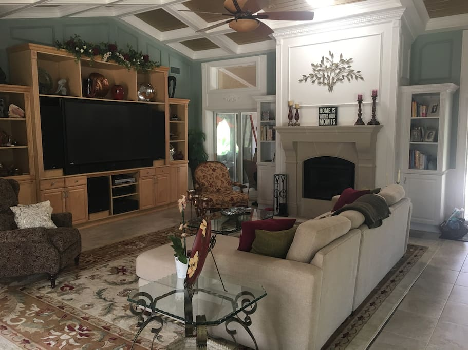 """Living room with 73"""" TV and electric fireplace"""
