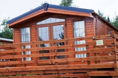 Modern and stylish, yet comfy and cozy.  Hot Tub Lodge for 4 guests on Felmoor Park, Northumberland.  Dog friendly too