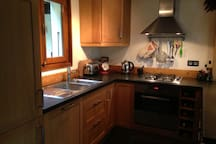 Kitchen with gas hob and electric oven, fridge frrezer and dishwasher