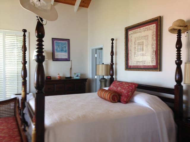 Bougainvillea Master Suite with adjoining private bath and views to Caribbean.