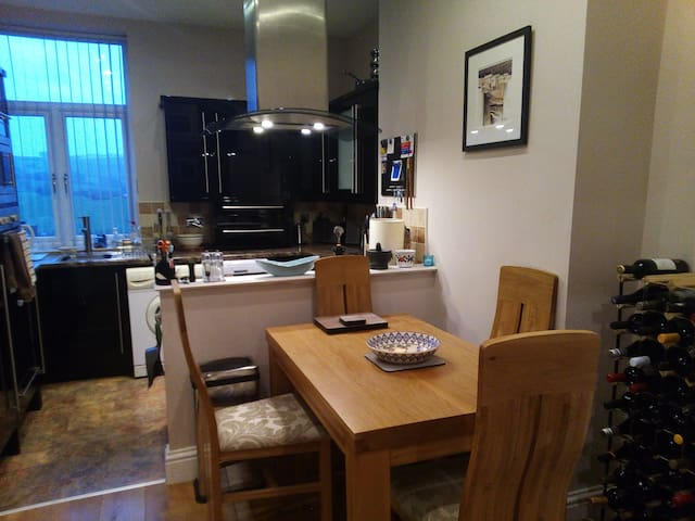 Dining area and kitchen with further double radiator