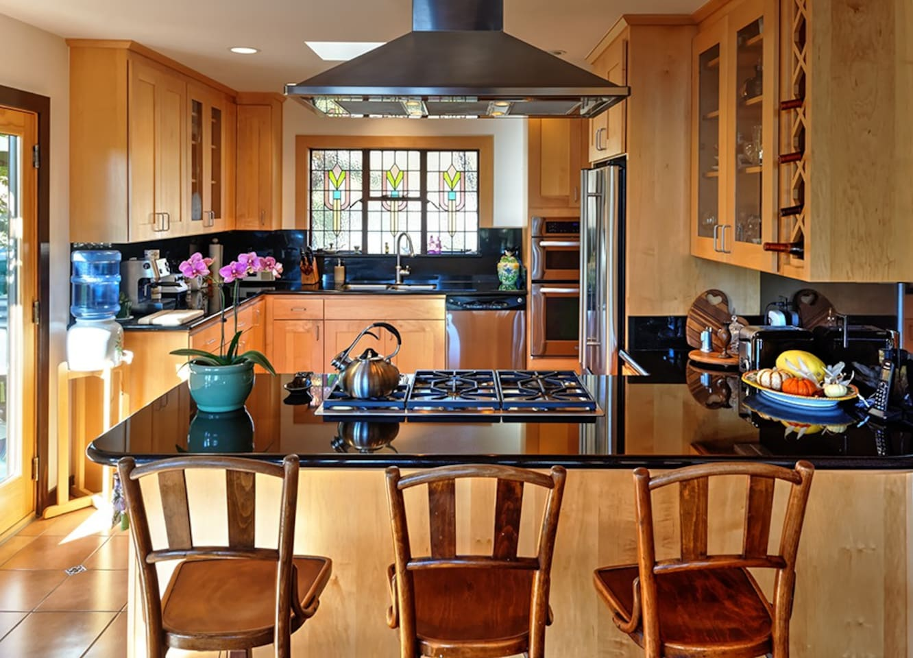 Gourmet kitchen with breakfast bar and granite countertops