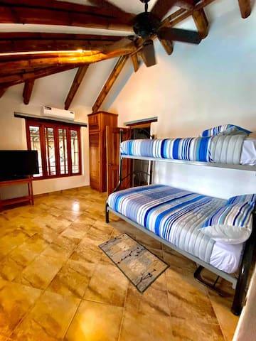 room #2: bottom bunk is a queen mattress and the top is a full mattress.
