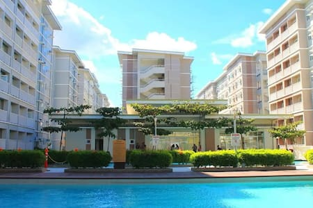 Mikhail Comfy Place 1BR w/ WIFI @ Trees Residences