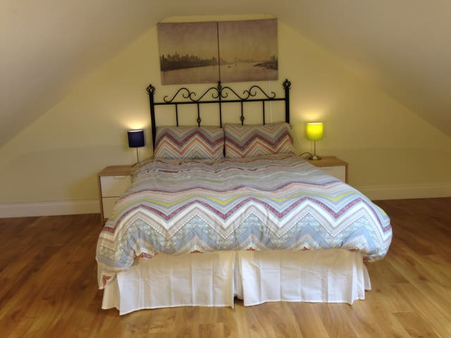 One very large dormer bedroom with double bed ...