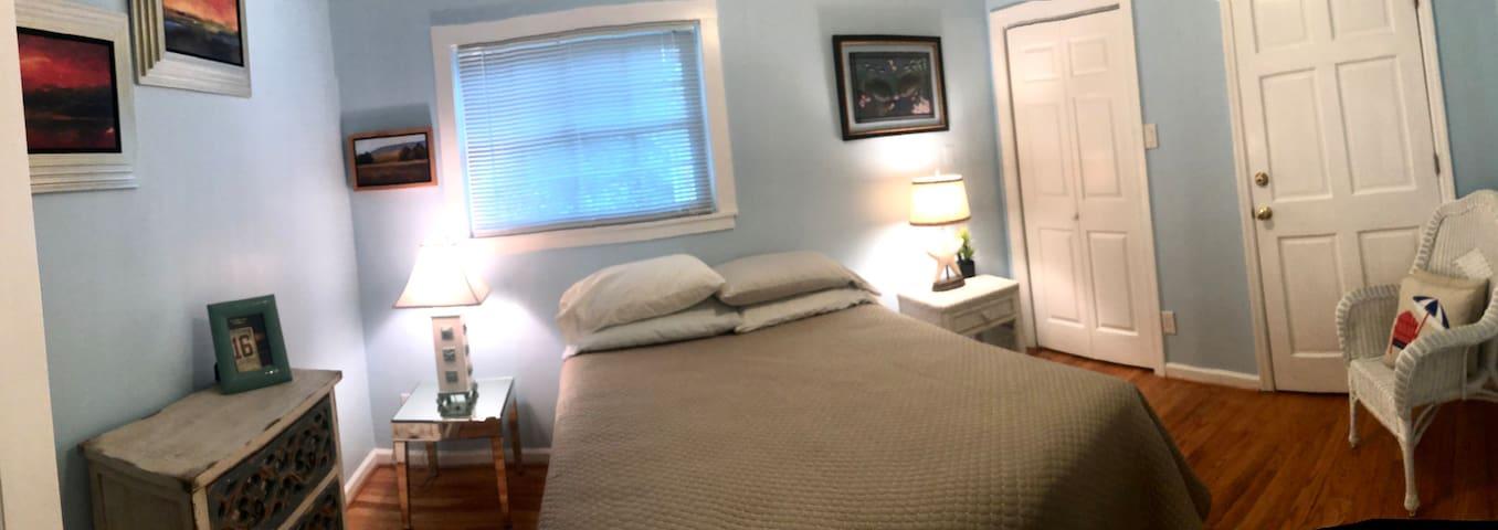 2nd Bedroom with a Foam Queen Bed on hardwood floors ; >