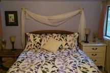 Queen size bed in Winter with down comforter and flannel sheets