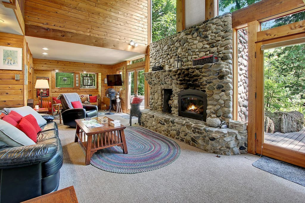 The river rock fireplace is a cozy touch at any time of year.
