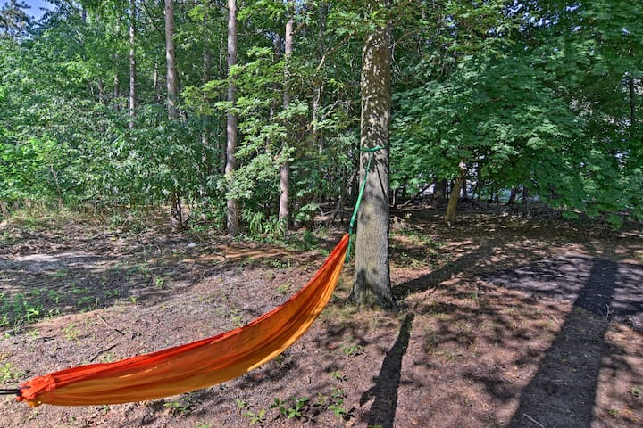 Optimal holiday relaxation awaits at this vacation rental nestled in the woods.