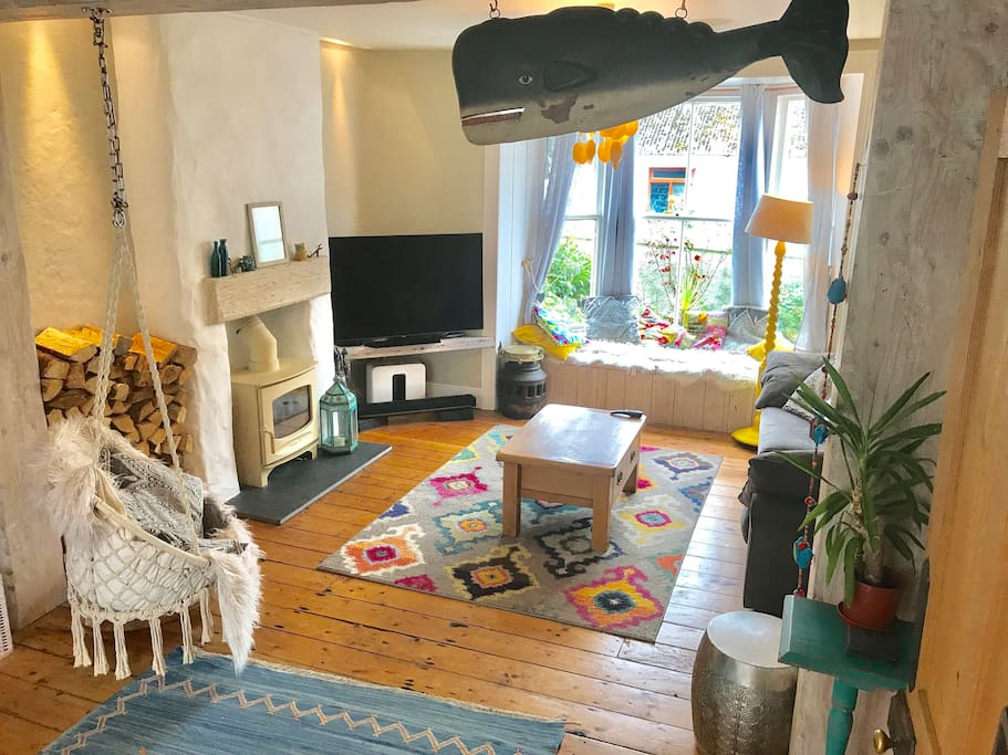 Large open plan living area...cosy boho with Netflix and toys games books galore