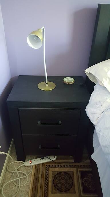 Night stand offers drawer space and a place to put a cup of coffee or glass of wine.