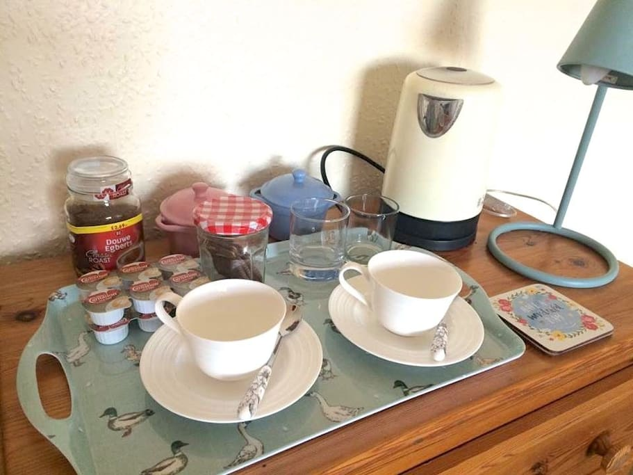 Tea and coffee making station in your room, biscuits may vary!