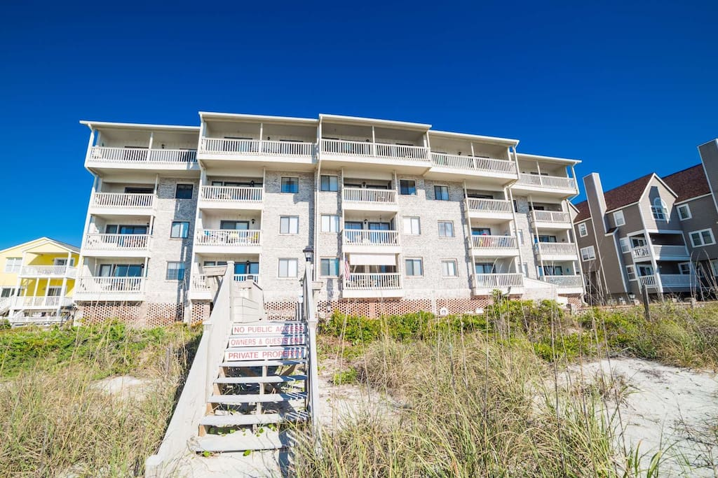 Surfwatch 111 is an oceanfront condo building with a outside pool and sundeck