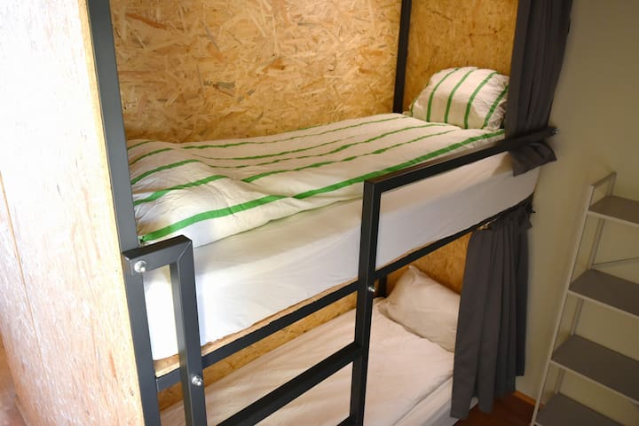 Single Enclosed Bunk Bed in 6-Bed Dorm Room