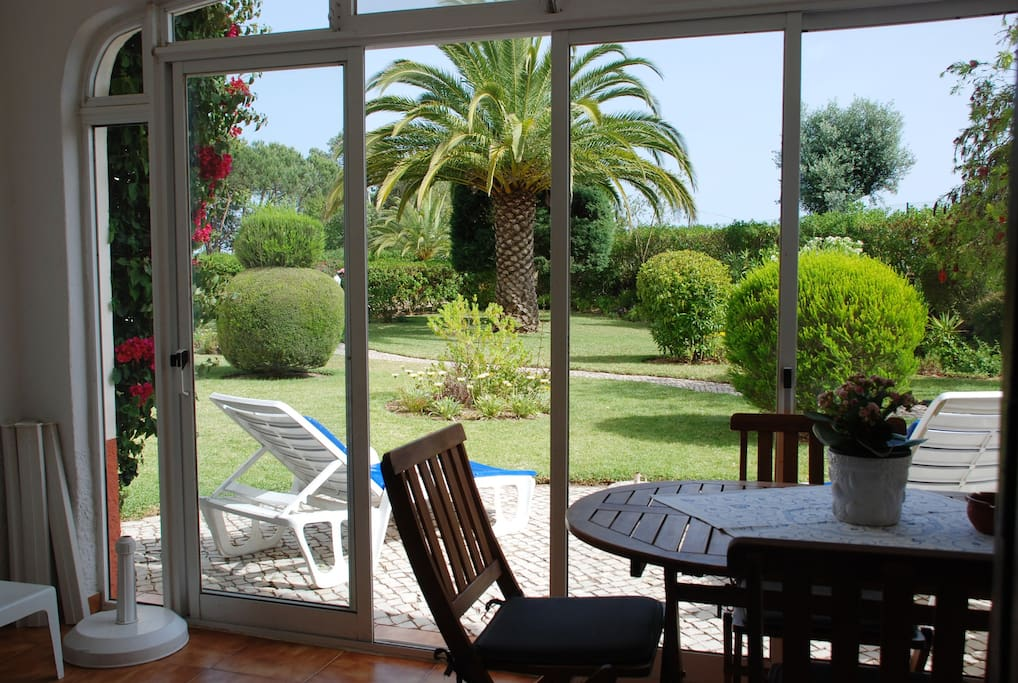 Lovely sunny patio which leads out onto mature gardens and swimming pool