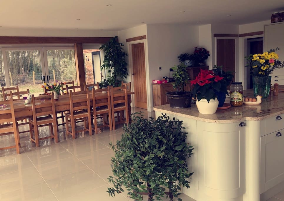 Large dining table with double aspect views onto patio and garden