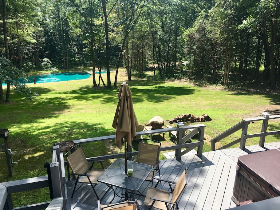 View of the new pond, our yard, hot tub, firepit, grill & outdoor dining area
