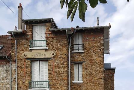 Appartement 2 chambres en pavillon - Carrières-sur-Seine