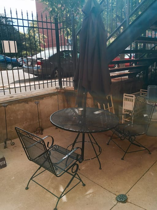 Comfy patio! Great for outdoor dining or just enjoying a drink or snack. There is a charcoal grill that you can use.
