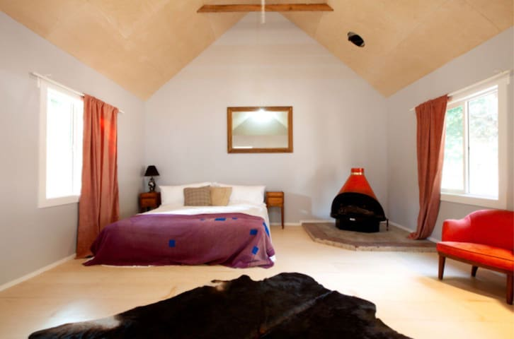 Serenity is here.  King size bed in spacious light infused and airy cabin.