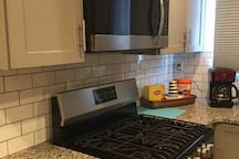 Kitchen - we offer coffee maker, microwave, toaster, table for 4, wine and can opener, glasses, cooking ware, refrigerator, electric oven, sink, etc...