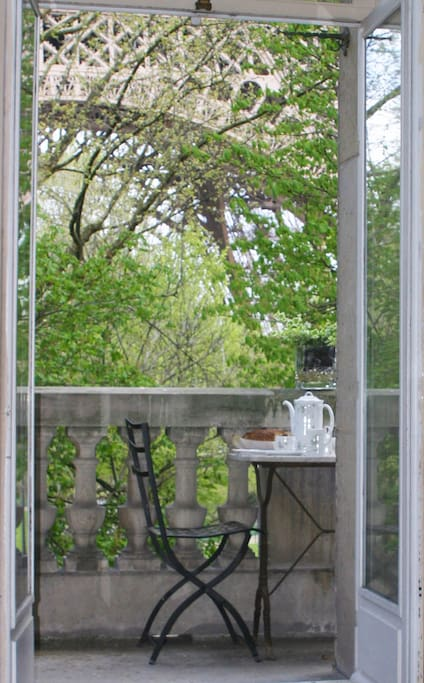 Breakfast on your balcony.  As close as you can get to the Eiffel Tower without actually being there.