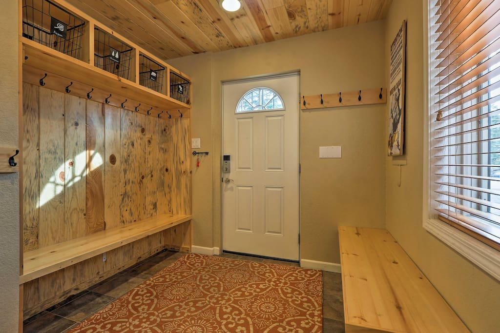 Convenient mud room with benches, ski storage, and cubbies for all your gear.