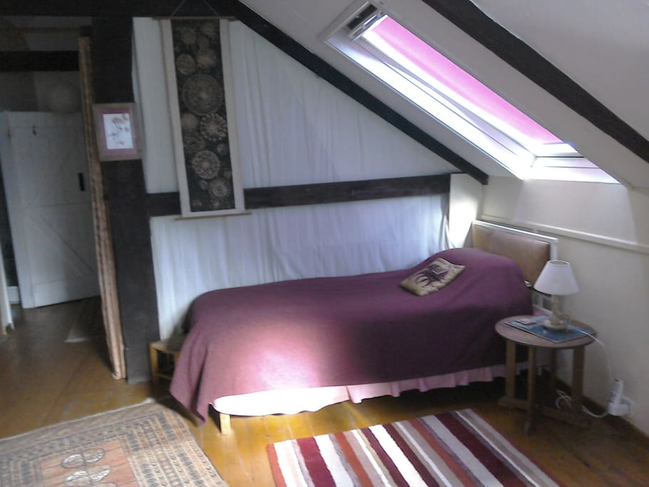 Single bed leading into main bedroom